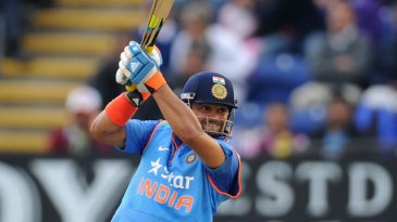 Suresh Raina launches an attack during his century