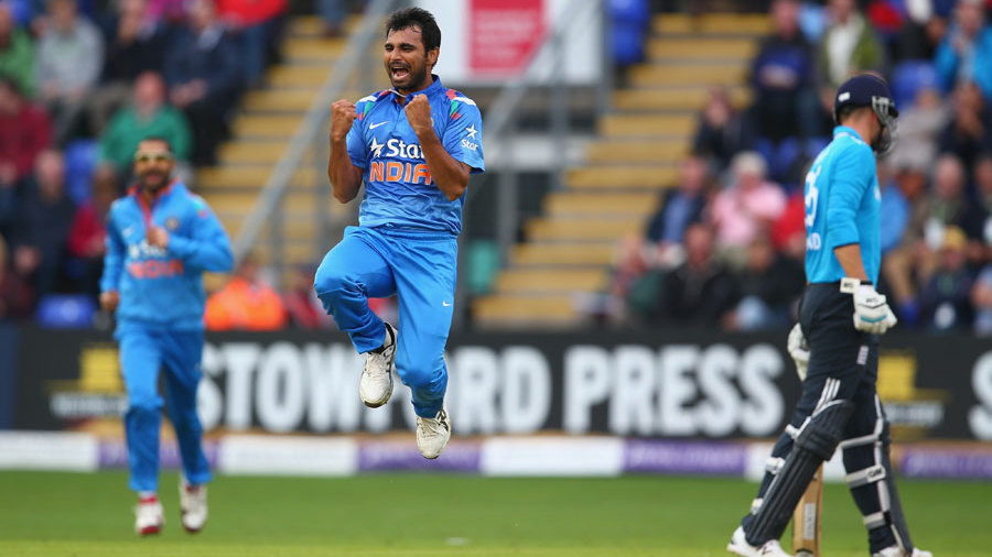 Mohammed Shami leaps in joy after bowling Ian Bell out