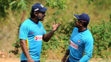 Kumar Sangakkara has a word with Rangana Herath during a practice session