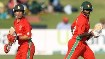 Sean Williams and Elton Chigumbura complete a run