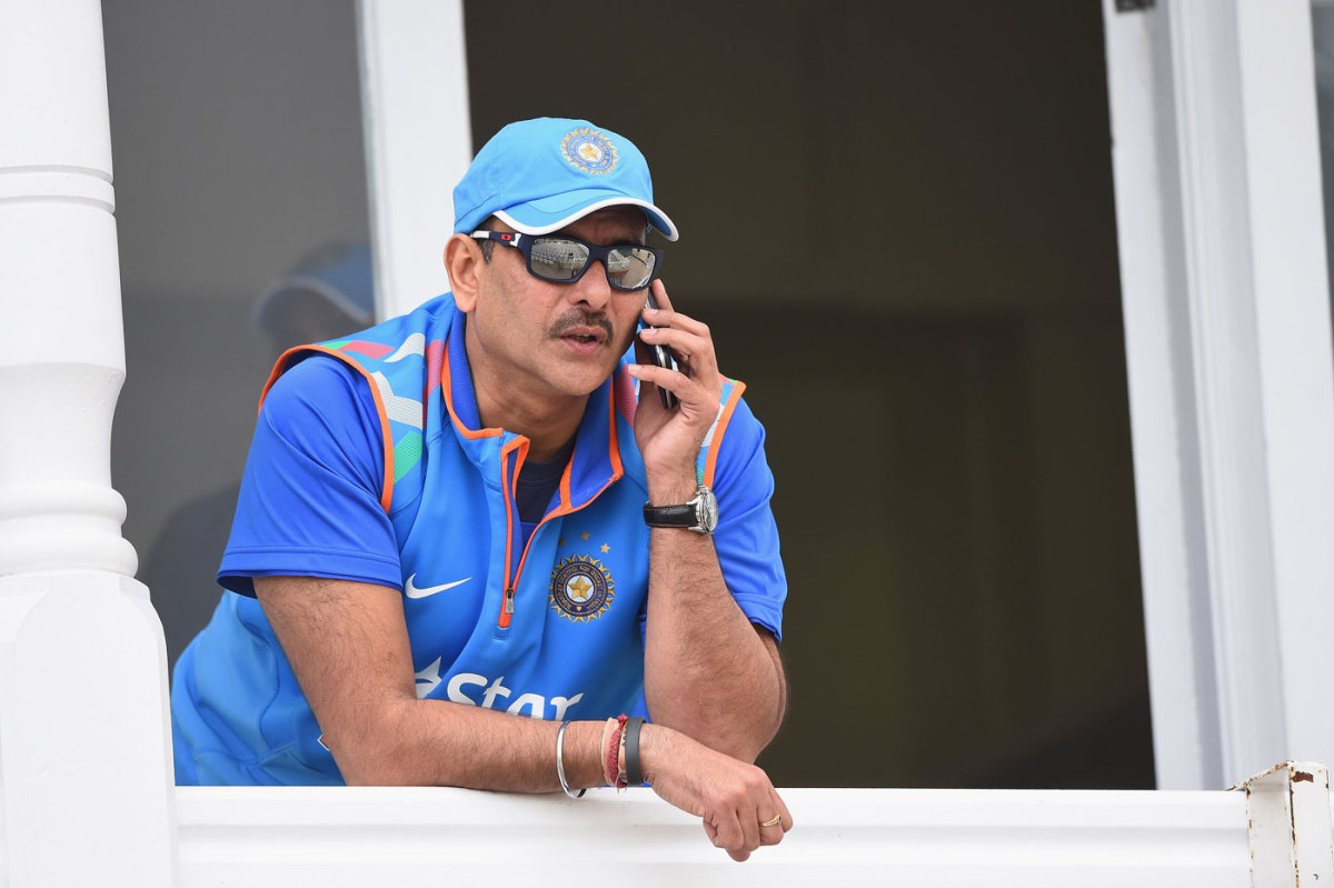 Ravi Shastri has a phone conversation during India's training session