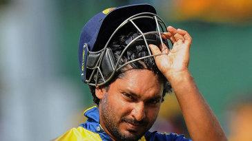 Kumar Sangakkara walks back for 2