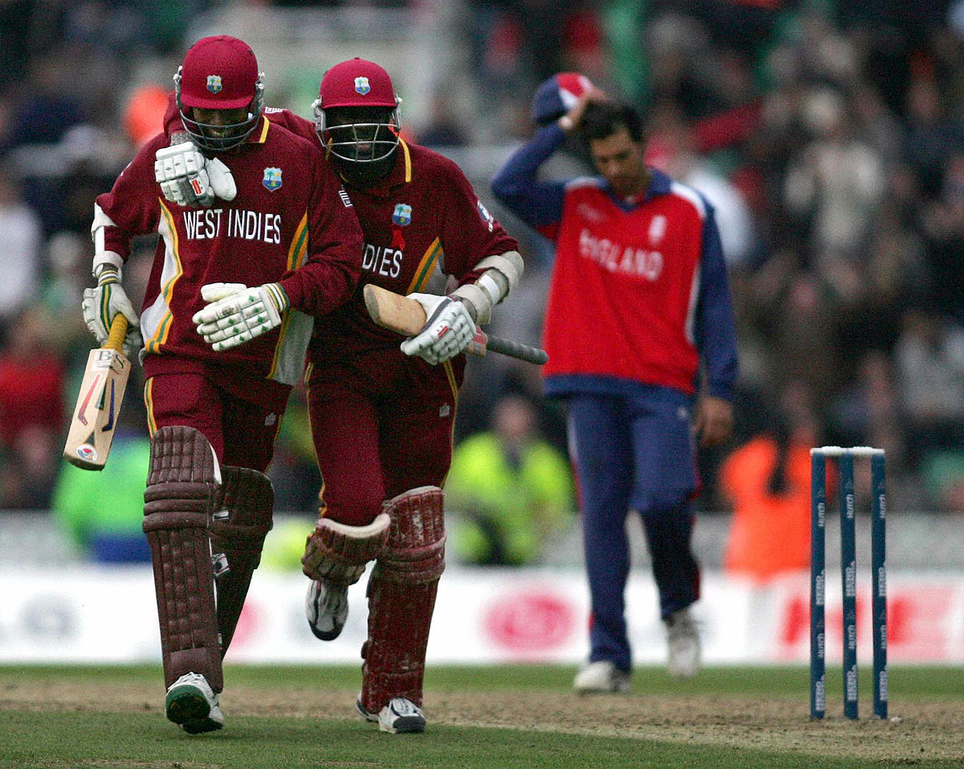 Ian Bradshaw and Courtney Browne celebrate their Champions Trophy heroics, England v West Indies, Champions Trophy final, The Oval, September 25, 2004