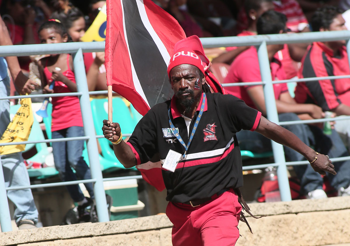 Jumbo the peanut seller carries a Trinidad & Tobago flag at Queen's Park Oval