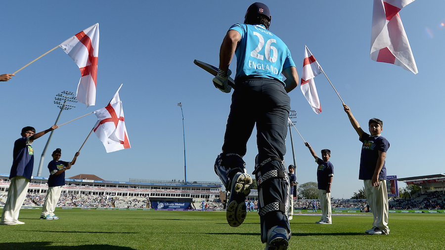 Alastair Cook jogs in to the pitch