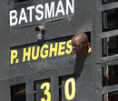 A scoreboard operator peeps out to catch some action, Australia v South Africa, tri-series, Harare, September 2, 2014
