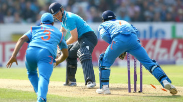 MS Dhoni completes the stumping with Eoin Morgan out of his ground
