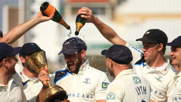 What a waste of champagne: Tim Bresnan gets drenched
