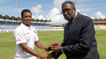 Leon Johnson receives his West Indies Test cap from Clive Lloyd