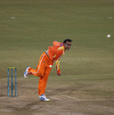 Adnan Rasool delivers the ball, Mumbai Indians v Lahore Lions, CLT20 qualifier, Raipur, September 13, 2014