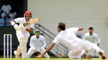 Leon Johnson drives Shafiul Islam down the ground