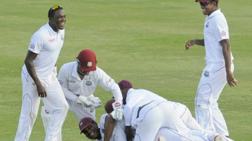 Shannon Gabriel's team-mates pile up on top of him after he took a catch