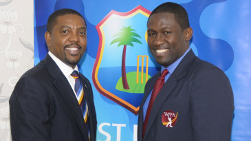 Dave Cameron and Wavell Hinds at the agreement-signing ceremony