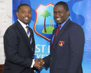 Dave Cameron, the WICB president, and Wavell Hinds, the WIPA president, at the agreement-signing ceremony, Bridgetown, September 18, 2014