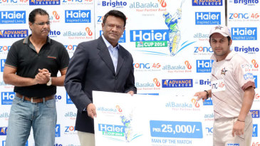 Azeem Ghumman receives the Man-of-the-Match award for his unbeaten 50