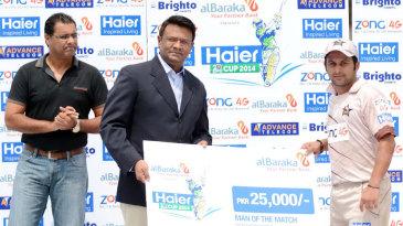 Azeem Ghumman receives the Man-of-the-Match award for his unbeaten 50