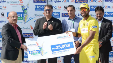 Zohaib Khan receives the Man-of-the-Match award
