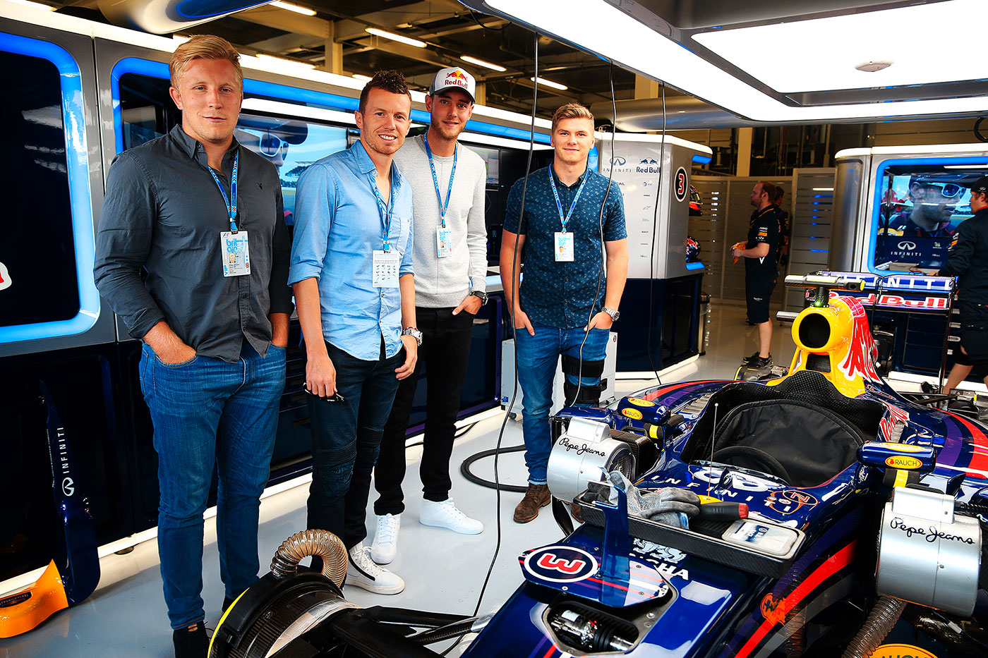 With occasional team-mate and opponent Stuart Broad, and (from left) rugby players Jackson Wray and Owen Farrell in the Red Bull garage at Silverstone
