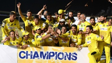 The victorious Peshawar Panthers side with the trophy