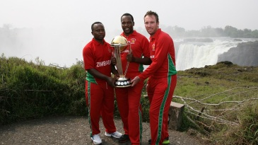 Prosper Utseya, Hamilton Masakadza and Brendan Taylor with the World Cup trophy at Victoria falls