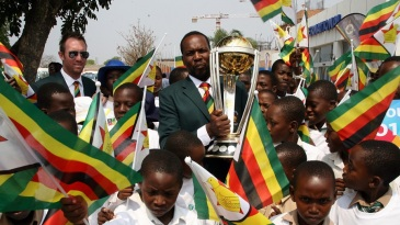 Hamilton Masakadza and Brendan Taylor with the World Cup trophy