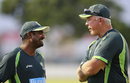 Muttiah Muralitharan has a chat with Craig McDermott during a training session, Dubai, October 2, 2014