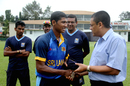 Thiran Dhanapala gets his Under-19 cap from Ranjan Madugalle, Colombo, October 3, 2014