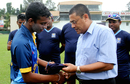 Saveen Nanayakkara receives his cap on Under-19 debut from Ranjan Madugalle, Colombo, October 3, 2014