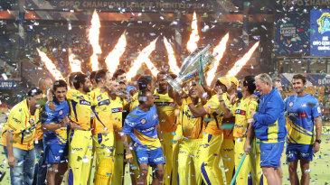 The Chennai Super Kings players celebrate with the Champions League trophy
