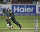 Raza Hasan loses the bat while completing a run, Pakistan v Australia, only T20I, Dubai, October 5, 2014