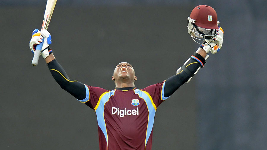 Marlon Samuels exults after scoring a century