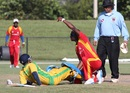 Ravi Timbawala gets assistance from Barrington Bartley after suffering knee injury, New York v South West, USACA T20 National Championship, Lauderhill, August 16, 2014