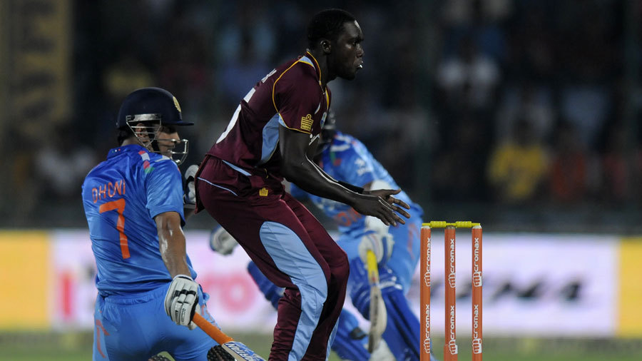 Oops.. MS Dhoni avoids a collision with Andre Russell