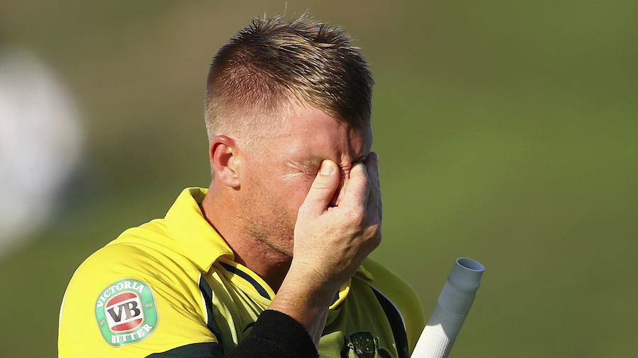 David Warner walks back after being dismissed