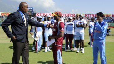 The West Indian team stood behind Dwayne Bravo at the toss
