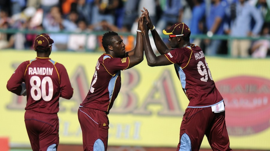 Andre Russell and Jason Holder celebrate a wicket