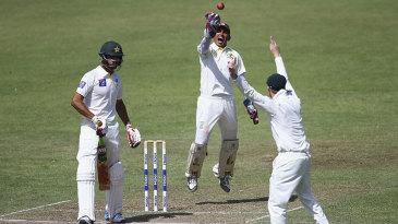 Australia's stand-in wicketkeeper Saqlain Haider celebrates a catch
