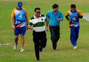 Mushfiqur Rahim, Minhajul Abedin and Akram Khan run to take shelter from the rain, Chittagong, October 17, 2011
