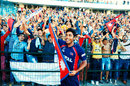 Avinash Karn celebrates with Nepal's fans after they qualified for the World T20, Hong Kong v Nepal, ICC World Twenty20 Qualifier, quarter-final, Abu Dhabi, November 27, 2013