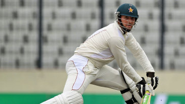 Brendan Taylor squeezes the ball into the off side