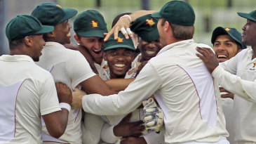 The Zimbabwe team celebrate a wicket