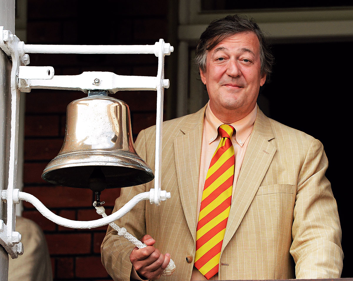 British actor Stephen Fry rings the five-minute bell ahead of the second day's play