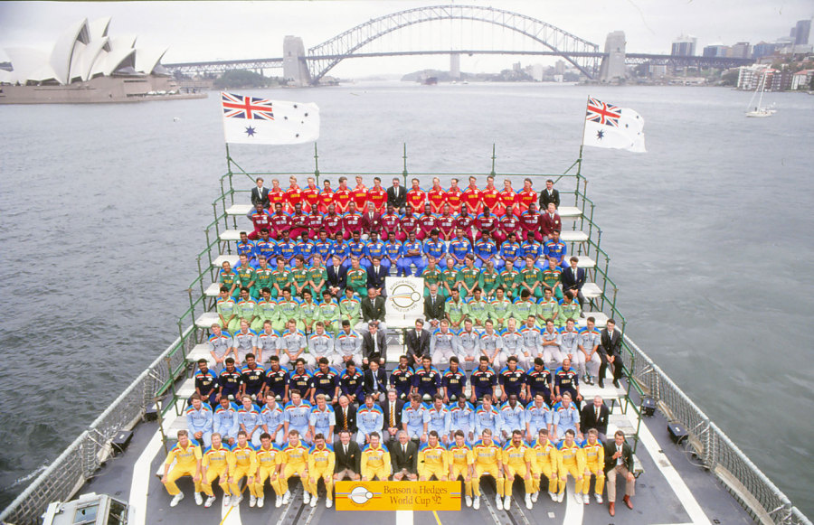 The nine teams and officials line up for photos on a ship in Sydney Harbour