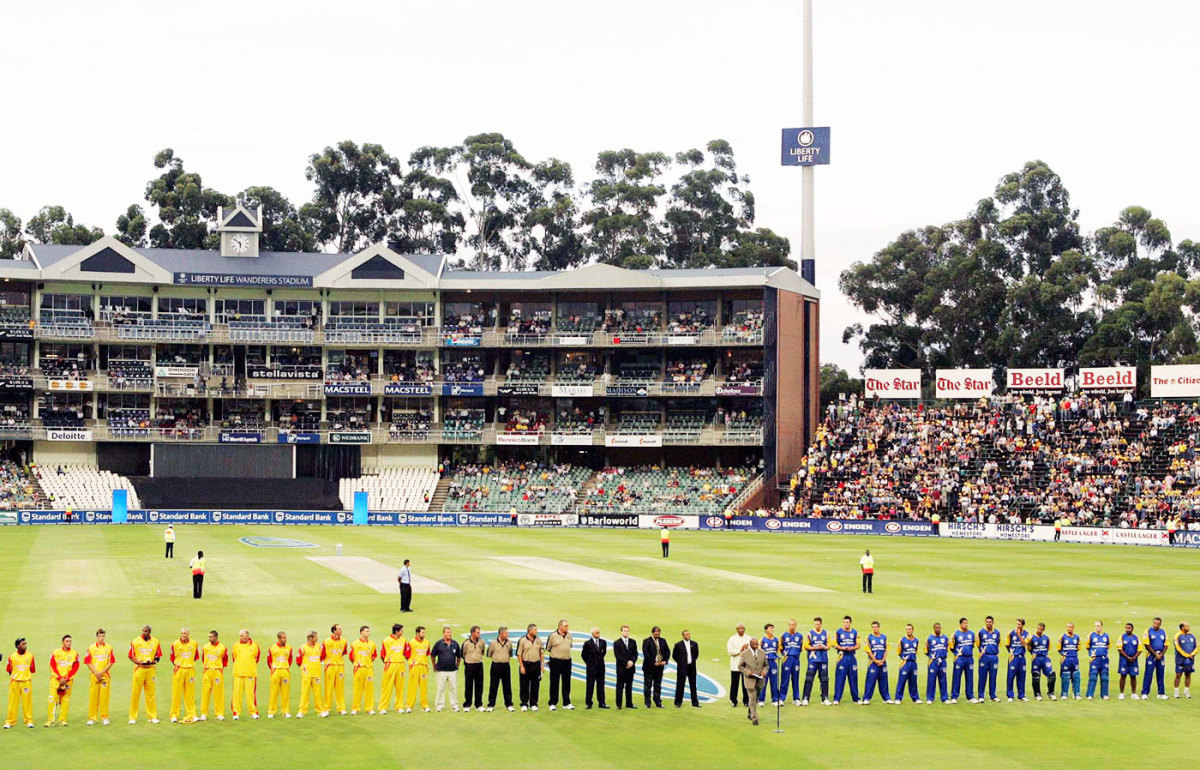 Players from both sides line up for a minute's silence to mark the passing of Bob Woolmer