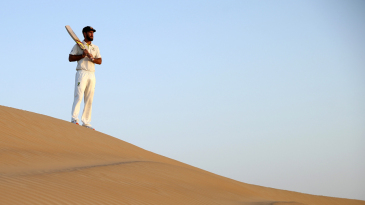 Glenn Maxwell looks out over the Al Khatim Sand Dunes