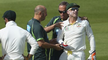 Brad Haddin gets his shoulder checked by Alex Kountouris and Peter Brukner