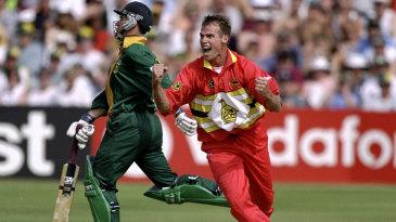 Neil Johnson celebrates a wicket