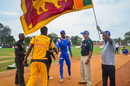 Michael Tissera (second from right) looks on during the toss, Oddusudan, October 31, 2014