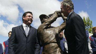 David Boon and Allan Border stand next to a statue of Boon