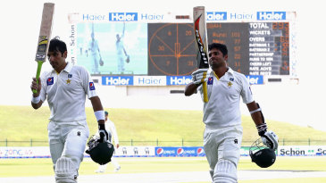 Misbah-ul-Haq and Azhar Ali walk off after scoring tons
